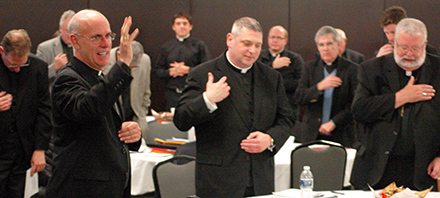 Bishop Kevin C. Rhoades of the Diocese of Fort Wayne-South Bend offers a blessing to priests of the Diocese of Peoria after his presentation at their Assembly Days on Oct. 27.