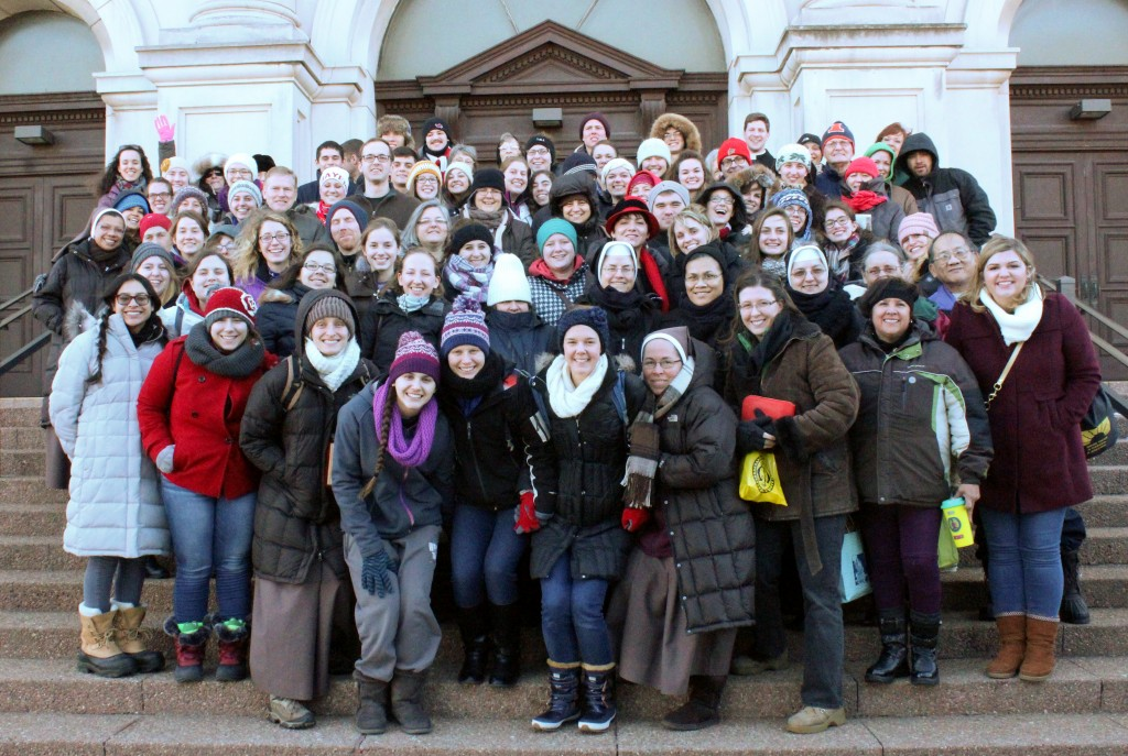 Those on the bus pilgrimage sponsored by the Diocese of Peoria are pictured on the steps of Our Lady of Sorrows Basilica in Chicago after Mass and lunch. The Catholic Post/Jennifer Willems