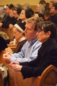 Lisa and John Weber and Sister Judith Ann Duvall, OSF, pray the rosary during the Holy Hour of Reparation and Healing at St. Joseph Church in Peoria on Jan. 22. (The Catholic Post/Tom Dermody)