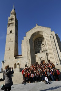 Students and staff from Peoria Notre Dame High School  pose on the steps of the Basilica of the National Shrine of the Immaculate Conception in Washington Jan. 21 after arriving for the opening Mass of the National Prayer Vigil for Life. CNS/Gregory A. Shemitz