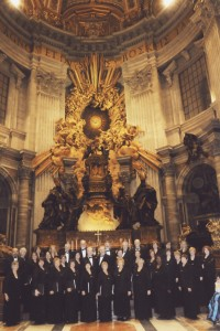 The 31-member choir poses for a photo in front of the Altar of the Chair of St. Peter and St. Peter's Basilica after singing for Mass. (Provided photo)
