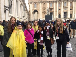 In St. Peter's Square are members of Pueri Cantores Peoria (from left) Kate and Mary Sanderson, Abby and Carrigan Tucker, Mariel and Rachel Kottoor, and Megan Tucker, who got to shake hands with Pope Francis. (Provided photo)