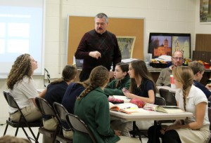 Father Willard works with the eighth-graders at St. Patrick School in Washington to prepare them for the sacrament of confirmation this April. (The Catholic Post/Jennifer Willems)