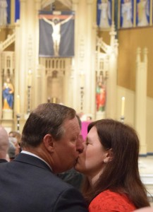 Steve and Colleen Hammel, members of Holy Cross Parish in Champaign, share a kiss during the Diocese of Peoria's Marriage Mass on Feb. 13 at St. Mary's Cathedral. (The Catholic Post/Tom Dermody)