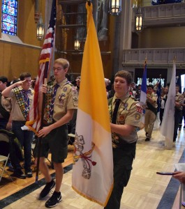 Eric Brose carries the Vatican flag and Ethan Scherder the U.S. flag in procession at the opening of the Scout and American Hertiage Girls Mass at St. Mary's Cathedral in Peoria. Both are members of Troop 156 in Peoria. (The Catholic Post/Tom Dermody)