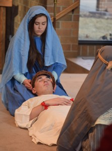 Mary (Rachel Sears) holds the body of Jesus (Ryan Hartsock) taken down from the cross. (The Catholic Post/Tom Dermody)