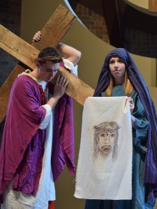 The Sixth Station is depicted by Ryan Hartsock as Jesus and Katie Kibler as Veronica. (The Catholic Post/Tom Dermody)