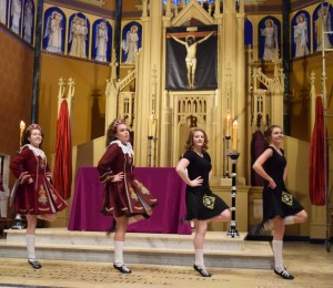 Members of Flynn's Irish Dancers perform in the sanctuary of St. Mary's Cathedral in Peoria prior to the 8 a.m. St. Patrick's Day Mass celebrated by Bishop Daniel R. Jenky, CSC. The dancers are, from left, Ella Dotson, Meghan Willerton, Maddy George and Kate Sanderson. (The Catholic Post/Tom Dermody)