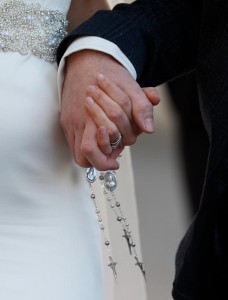 A newly married couple hold rosaries in their hands as they leave Pope Francis' general audience in St. Peter's Square at the Vatican Feb. 24. (CNS/Paul Haring)