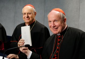 "Cardinal Lorenzo Baldisseri, general secretary of the Synod of Bishops, and Austrian Cardinal Christoph Schonborn, holds a copy of Pope Francis' apostolic exhortation on the family, ""Amoris Laetitia"" (""The Joy of Love""), during a news conference for the document's release at the Vatican April 8. (CNS/Paul Haring)"