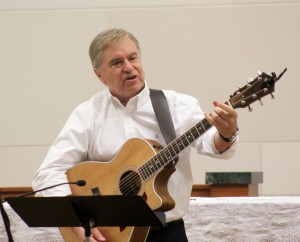 Dan Schutte paired his reflections on the goodness and unfailing love of god with songs he had written, encouraging people to sing their hearts out. (The Catholic Post/Tom Dermody)