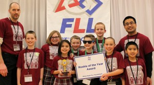 The St. Jude Catholic School Firecrackers pose with the Rookie Team Award they earned at the Illinois Central First Lego League State Tournament earlier this year in Champaign. Team members include, from left, Coach Tim Goldammer, Lincoln Dillavou, Addi Ralph, Cattleya Fortmann, LJ Higgs, Harry Penne, Eliot Lynch, Will Goldammer, Nathan Ninnam and Coach Neil Ninnam. (Provided photo)