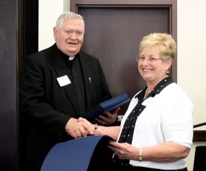 Sandra Gasparovich of St. Anthony in Bartonville receives her certificate of appreciation from Msgr. Dale Wellman, longtime spiritual adviser for the Diocesan Council of Catholic Women and former pastor.