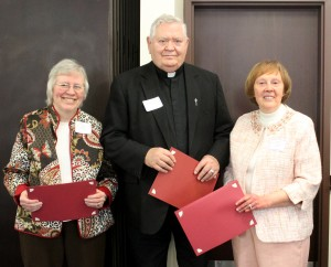 For their work to organize the Mary and Monica Helpers at St. Edward Parish in Chillicothe, Gail Kruse (left) and Diane Hahn received the Imperative Award at the DCCW's Volunteer Appreciation Luncheon April 14. Shown with them is Msgr. Dale Wellman, DCCW spiritual adviser. (The Catholic Post/Jennifer Willems)