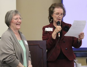 Agnes Christman, president of the Peoria Diocesan Counciil of Catholic Women, makes Joan Weber laugh as she shares the many reasons why the longtime volunteer was being honored with the DCCW's Diocesan Award. (The Catholic Post/Jennifer Willems)
