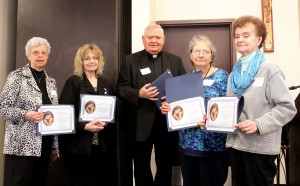 Four members of St. Michael the Archangel Parish in Streator were honored at the DCCW Volunteer Appreciation Luncheon on April 14. Flanking Msgr. Dale Wellman are (from left) Joyce Redfern, Connie Barton, Michelle Henne and Mariilyn Richard. (The Catholic Post/Jennifer Willems)