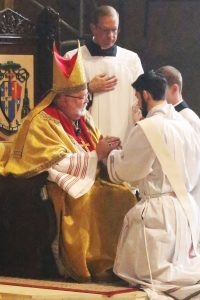 Bishop Jenky anoints the hands of Father Michael Pica with Sacred Chrism. (Photo courtesy of Dave Devall)