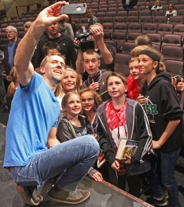 Chris Stefanick takes a selfie with some of the students from St. Patrick School in Washington. (The Catholic Post/Jennifer Willems)