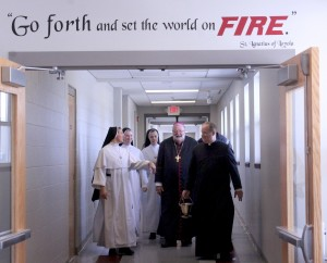Bishop Jenky walks down the long hall that now connects St. Jude Church, Hettinger Hall and St. Jude School as he prepares to bless the new construction on April 24. Accompanying him are Father Patrick Henehan, pastor; Sister Maria Christi, OP, principal; Sister Maria Canisius, OP, and Sister Catherine Thomas, OP. (The Catholic Post/Jennifer Willems)