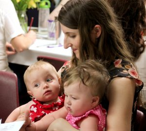 """Women of all ages attended """"Finding Your Fiat,"""" including 8-month old Gianna Brehm (right) and 9-month-old Gianna Tepen. Holding them during a break is Jenny Brehm of Oak Park. (The Catholic Post/Jennifer Willems)"""