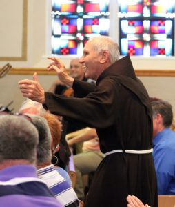 "Inspired by the song, ""And the Father Will Dance,""  Father Neri Greskoviak, OFM, parochial vicar, got up and did just that. (The Catholic Post/Jennifer Willems)"