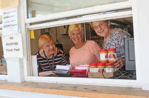 Those who visited the food pantry on a recent Friday were greeted by Nancy Elson, Vicki Pettett and Phyllis Kovachevich. (The Catholic Post/Jennifer Willems)