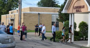 After praying the rosary in church Monday night, members of St. Edward Parish enter Longman Hall for a meeting on an announced closing of the parish school. (The Catholic Post/Tom Dermody)
