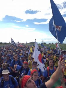 "Those taking part in a World Youth Day Pilgrimage sponsored by the Servants of the Pierced Hearts of Jesus and Mary join the throngs walking to the ""Field of Mercy"" near Krakow, Poland. (Provided photo)"