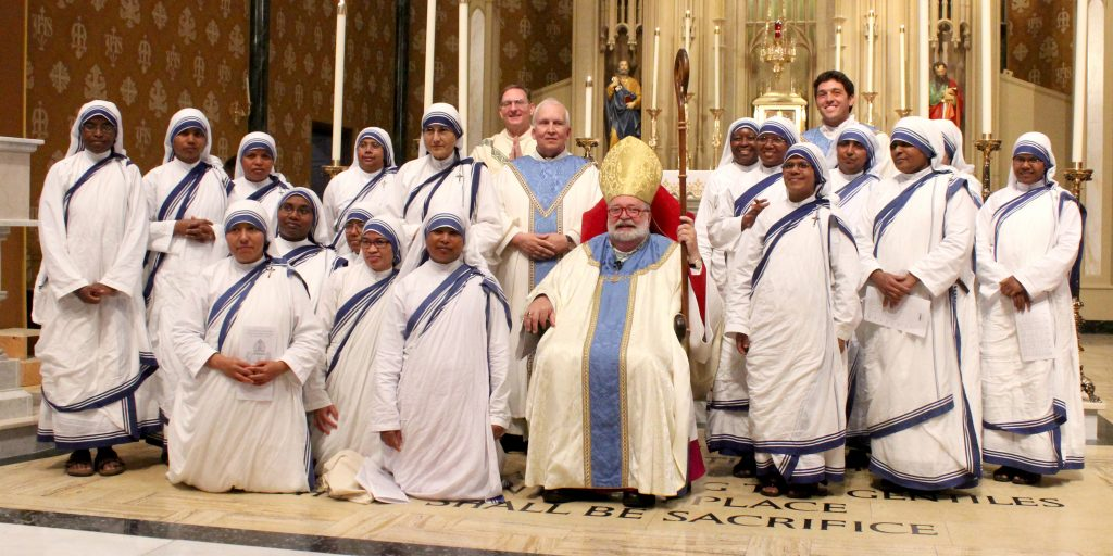Missionaries of Charity who serve in central Illinois and the other members present in the cathedral pose with Bishop Jenky and concelebrating priests following the Sept. 10 Mass. (The Catholic Post/Jennifer Willems)