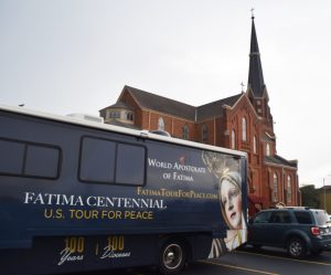 "The bus transporting the International Pilgrim Virgin Statue of Fatima on its two-year ""Fatima Centennial U.S. Tour for Peace"" is parked outside Corpus Christi Church in Galesburg on Sept. 16. (The Catholic Post/Tom Dermody)"