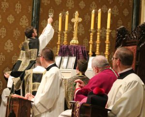 Father Alex Millar elevates the chalice during Requiem Mass celebrated in the extraordinary form at St. Mary's Cathedral on Aug. 24, the eve of the 100th anniversary of the death of Bishop John Lancaster Spalding, the founding bishop of Peoria. (The Catholic Post/Jennifer Willems)