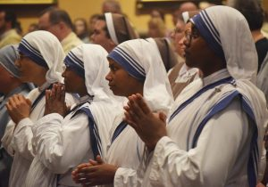 The four Missionaries of Charity serving in Peoria are pictured during a recent Mass at St. Mary's Cathedral. (The Catholic Post/Tom Dermody)