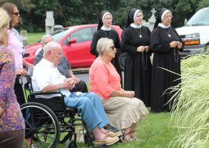 Among those praying the rosary at the Bishops' Mausoleum at St. Mary's Cemetery in West Peoria on Aug. 25 were John and Mary Slevin, members of St. Ann Parish in Peoria. John's grandmother was the sister of Bishop John Lancaster Spalding, the first bishop of Peoria who died 100 years ago. (The Catholic Post/Jennifer Willems)