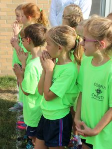 Praying for the success of the building project are second-graders Sadie Siegmund, KaleighAnne Poppins, Bradyn Marconi, Grant Hageman, Lily Wait and Allison Emm. (The Catholic Post/Jennifer Willems)