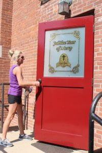 Kris Pilkington of Immaculate Conception Parish in Carthage was the first pilgrim to complete the Walk to Mercy and go through the Holy Door at Sts. Peter and Paul Church in Nauvoo. (The Catholic Post/Jennifer Willems)