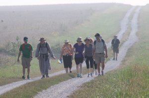Despite the changing terrain, road surfaces and weather, pilgrims making the Walk to Mercy through Hancock County kept going. This group received encouragement and spiritual support from Brother Benedict of the Community of St. John. (The Catholic Post/Jennifer Willems)