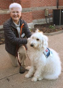 Sharon Cramer and Bailey, her therapy dog, have been a team since 2014. They recently were recognized for 100 facility visits. (The Catholic Post/Jennifer Willems)