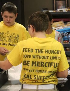 "The 17 students from St. Mary School in Pontiac wore t-shirts that declared their intention to ""Love Like Francis"" by serving others. (The Catholic Post/Jennifer Willems)"