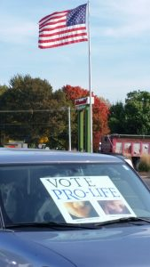 Some in the Champaign area are displaying the signs in their parked cars. (Provided photo)