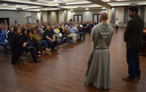 """More than 250 people attended the Nov. 5 screening of """"Outcasts"""" at Hettinger Hall of St. Jude Parish, Peoria. (The Catholic Post/Tom Dermody)"""