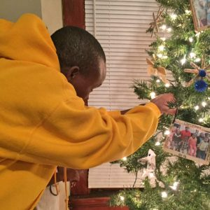 Kasaika Kabunze helps to decorate the family's first Christmas tree.