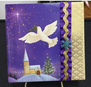 A ceramic tile decorated with faith-based art, ribbons and festive paper by the students was presented to each senior pen pal. (Provided photo)