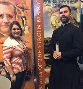 Caroline Cramsey of Warsaw, a student at Missoui Western State University, makes a friend at the booth of the Oblates of the Virgin Mary booth at SEEK 2017. (Provided photo)
