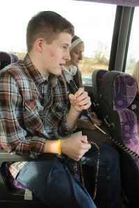 Andrew Belgri of the St. John Paul II Catholic Newman Center at Illinois State University leads the first decade of the Joyful Mysteries of the rosary as the group on the bus sponsored by the Diocese of Peoria travels to March for Life Chicago on Jan. 15. (The Catholic Post/Jennifer Willems)