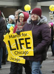 Suzie Meismer (foreground), Kathleen Abel and Karen Guth, all of Peoria, add March for Life Chicago to the long list of respect life witnesses they have undertaken over the years. (The Catholic Post/Jennifer Willems)