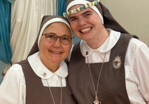 Sister Lucia Maria Sol, SCTJM, embraces her aunt, Sister Ana Margarita Lanzas, the vicar general of the Servants of the Pierced Hearts of Jesus and Mary, after professing her perpetual vows on Aug. 22 in Miami. (Provided photo)