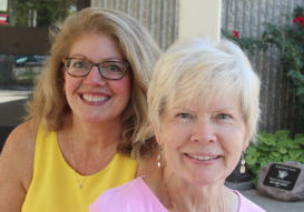 """Ann Williams' story of unplanned pregnancy, choosing life and adoption for her twin sons, and eventual reunion with them is told in a new book """"God's Handprints: A Story of Faith, Hope and Love"""" written by her niece, Bridget Nelan, left. (The Catholic Post/Jennifer Willems)"""