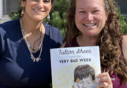 """Mariam Khoury Briggs, illustrator, and Bonnie Engstrom, author, of """"Fulton Sheen and the Very Bad Week"""" hold a copy of their new book, which was launched Sept. 16. (Provided photo)"""