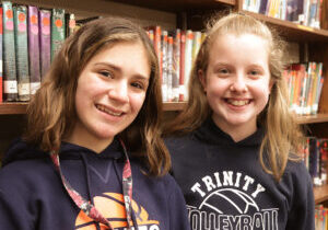 Alyssa Savitch (left) and Gabby Bulak, seventh-graders at Trinity Catholic Academy in LaSalle, put sewing skills learned from their mothers to good use when the COVID-19 pandemic made masks necessary last yuear. (The Catholic Post/Jennifer Willems)