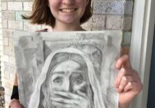 Katy Olsen, 15, of Epiphany Parish in Normal and a freshman at Chesterton Academy of the Sacred Heart in Peoria, holds her drawing of Mary Magdalene's reaction at discovering Jesus' empty tomb. (Provided photo)